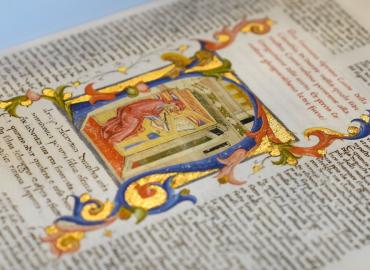 a miniature of the Dante Guarneriano depicts Dante in his studiolo