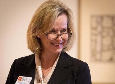 Mary Watt smiling looking off camera